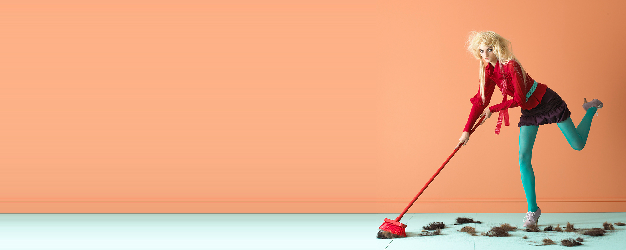 model sweeping with red broom